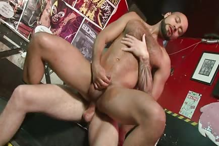 Muscle stud bouncing on cock