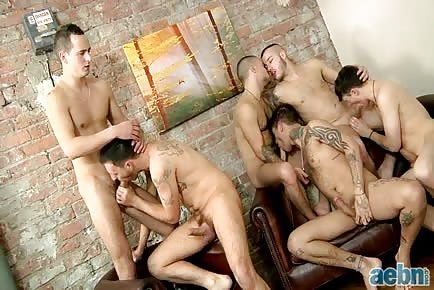 Massive gay tattoo orgy