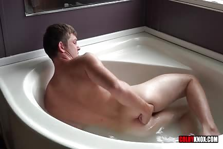 Fingering his asshole in the tub and cumming on himself