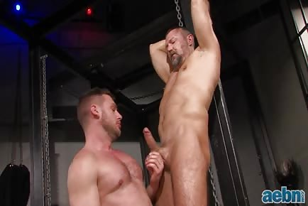 Mature hung daddy Mack Manus and younger hunk Hans Berlin enjoy gay sex