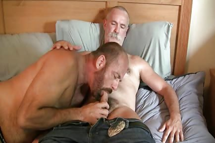Horny old dog gets cock eaten by other man