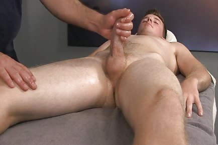 Young straight stud getting cock and balls massaged for first time