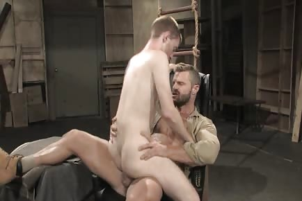 Sexy furry hunk tops twink in military barrack warehouse