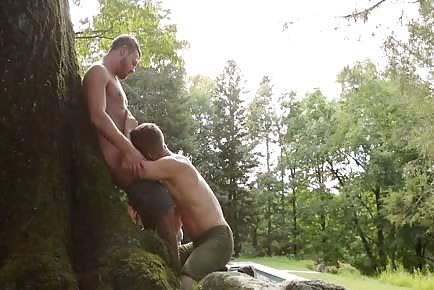 Hot guys fucking on a tree in the woods