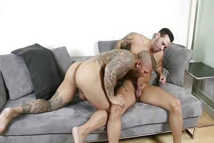 Tattooed meaty hunks fuck on the couch