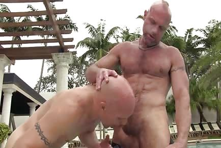 Mature daddy getting gentle cock attention by the pool