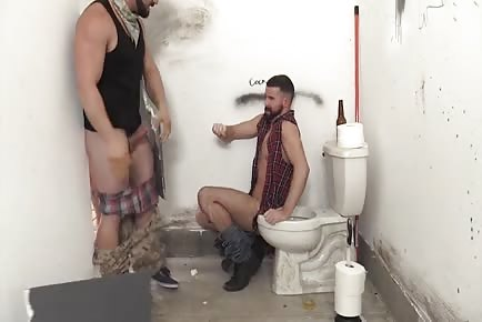 Rednecks piss on guy and gang fuck him raw in public toilet