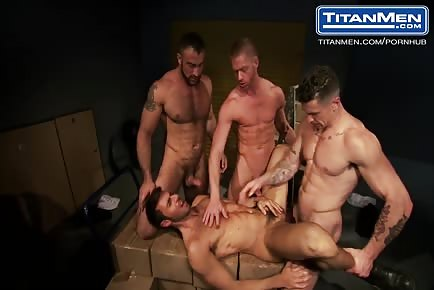 Beefy muscle guys gangbang in warehouse