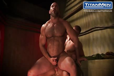 Bald muscular male daddy fucked by younger guy underground