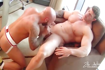 Huge bi-sex dude Zeb Atlas tops a jock strapped guy on his work desk