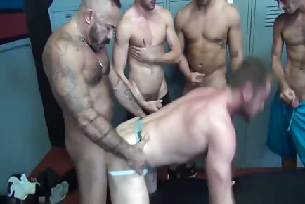 Five Horny Hunks Banging One Football Player In Locker Room
