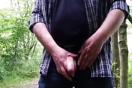 Boyfriend plays with boner in the woods